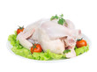 Raw crude chicken on a plate garnished with vegetables salad