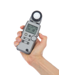 Light flash meter in hand isolated