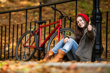 Urban biking - girl and bike in city park