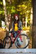 Urban biking - girl and bike in city park