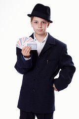 Portrait of a young boy holding playing cards