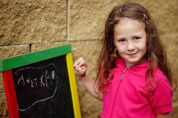 A girl writting on a board