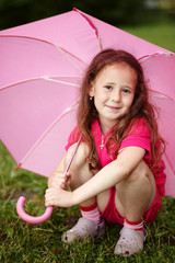 Portrait of a girl holding an umbrella