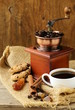 Still life of wooden coffee grinder, sugar, biscuits