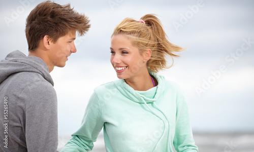 Romantic young couple on autumn beach