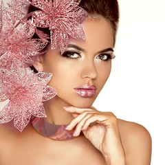 Beautiful Girl With Pink Flowers. Beauty Model Woman Face. Perfe