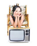 Young woman resting on old retro tv