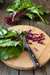chard leaves on a cutting board