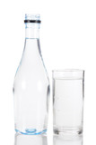 Water in glass and plastic bottle