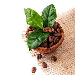 Coffee beans in a bowl with green leaves on a white background