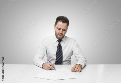 young man writing on paper