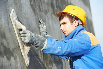 builder worker at plastering facade work