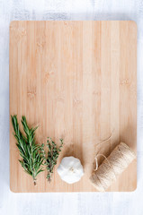 Overhead view of cooking ingredients on wooden board