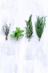 Mix herbs on rustic background