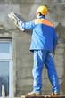 facade worker plastering wall