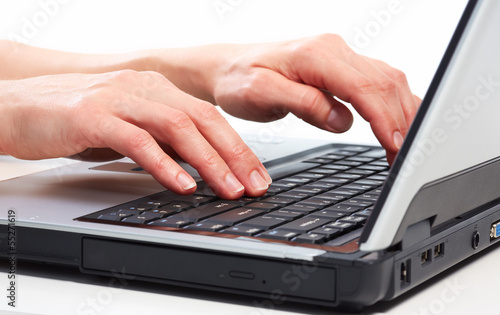 Hands with laptop computer.