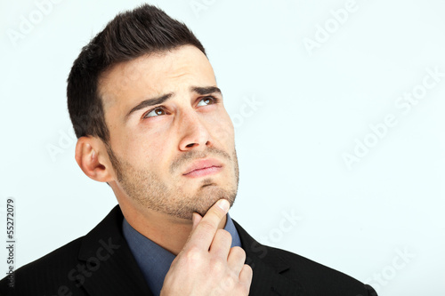 Thoughtful businessman with a hand on his chin