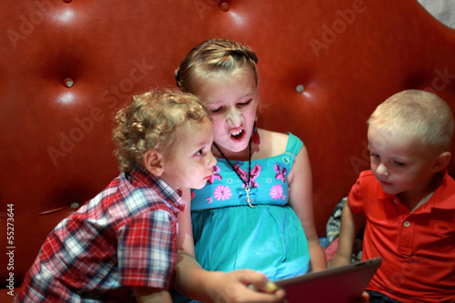 Children play with tablet PC