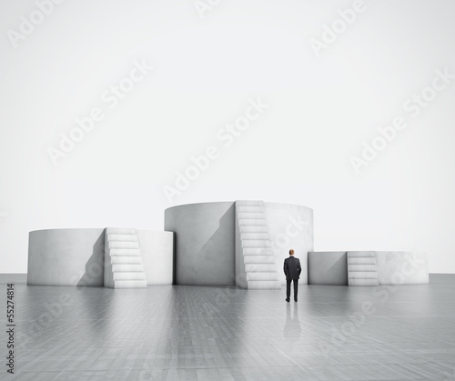 man looking at empty podium with stairs