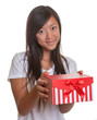 Smiling asian girl has a present