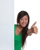 Asian woman showing thumb behind a signboard