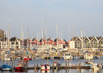View of small yacht harbor with houses in backgound