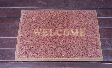 Used welcome carpet mat, welcome doormat carpet on the floor