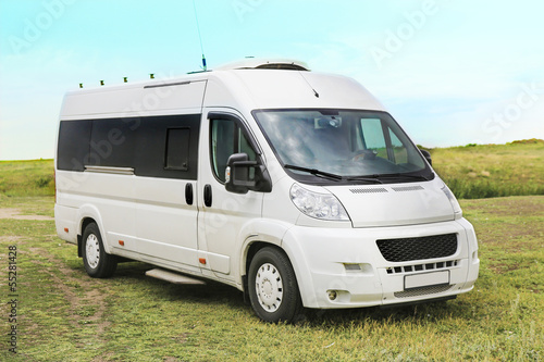 white minibus on in the field