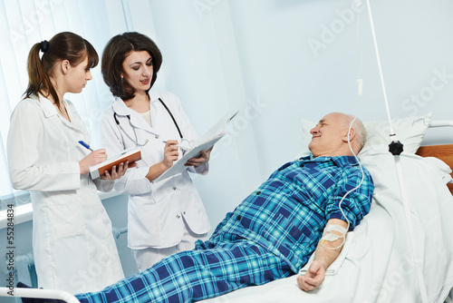 medic doctor in hospital with patient