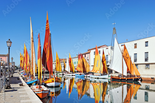 Boats of the Maritime Museum along the canal port in Cesenatico