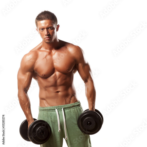 Muscular man holding weights and posing on a white background