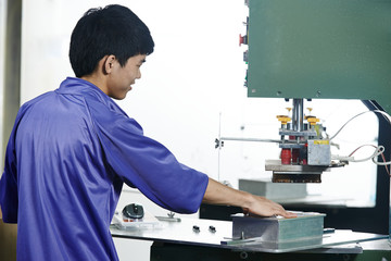 chinese worker operating press