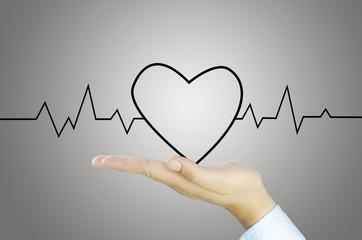 Heart draft and graph on Human hand
