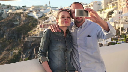 Couple taking photo with cellphone on Santorini