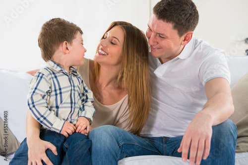 Beautiful happy family having fun at home