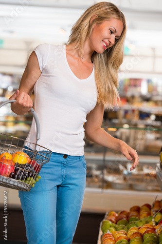 Casual woman grocery shopping
