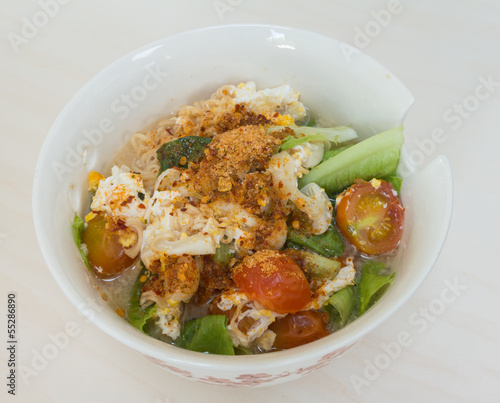 Thai vegetable noodle spicy in white bowl