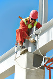 builder millwright worker at construction site poster