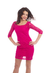 Attractive carefree young lady dressing pink dress posing