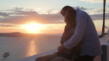 Couple looking at beautiful sunset over island