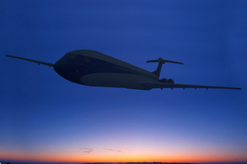 Silhouette of a boeing passenger jet aeroplane at sunset