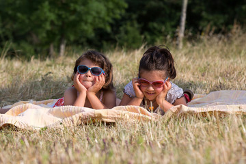 two little sisters playing with sunglasses, Outdoor Portrait