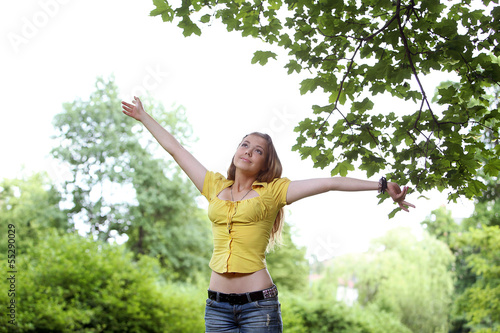 Beautiful girl posing in a park