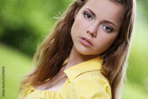 Beautiful girl posing in a park