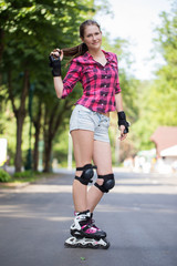 Girl posing in park with her blades on