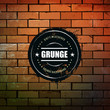 Grunge circle banner on brick wall