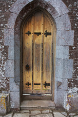 old tudor wooden oak door wih latches and locks