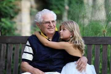 Portrait of grandfather and grand daughter