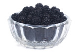 ripe blackberries in a glass bowl isolated on white background