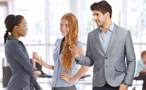 Businesspeople talking at office lobby